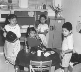 old picture of kids playing house